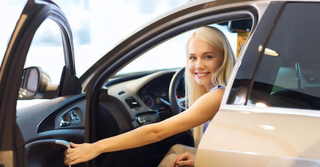 Young lady in a new car