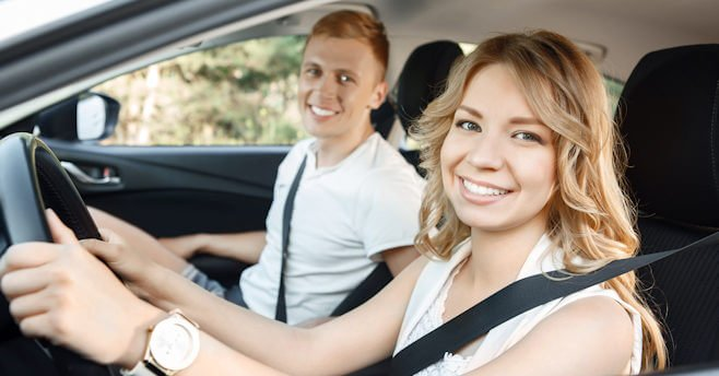 Young couple in their car